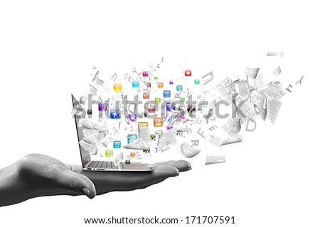 Close up of hand with laptop and media icons