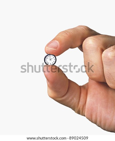close-up of hand with tiny clock