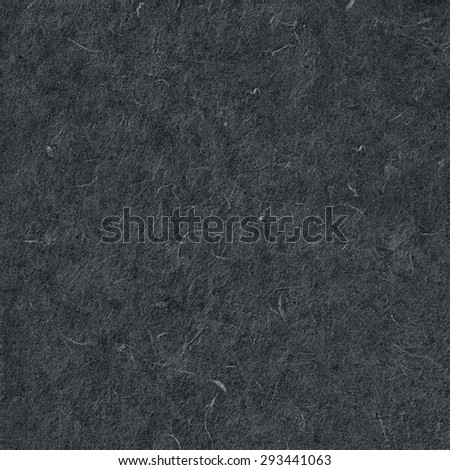 Close-up of Handmade fiber organic paper texture. Black background. Craft eco recycle coated handmade textured paper. Useful for scrapbooking and greeting, oriental cards design. Mulberry, Sa paper.