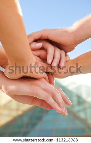 close -up of hands achieved an agreement and become a team