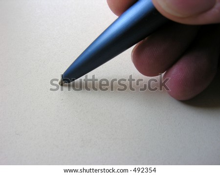 Close-up of hands beginning to write