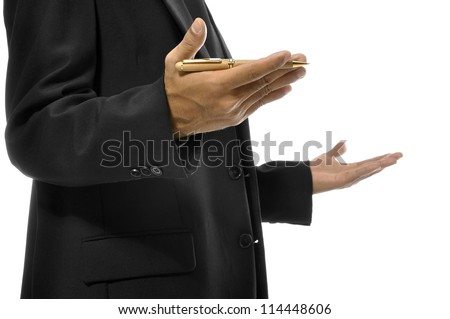 Close up of hands gesturing while holding pen and torso of man with business suit. Isolated over white background