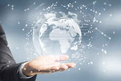 Close up of hands holding abstract glowing polygonal globe on blurry background. Network, communication and global innoovation concept