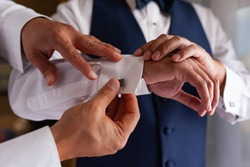close up of hands of groom