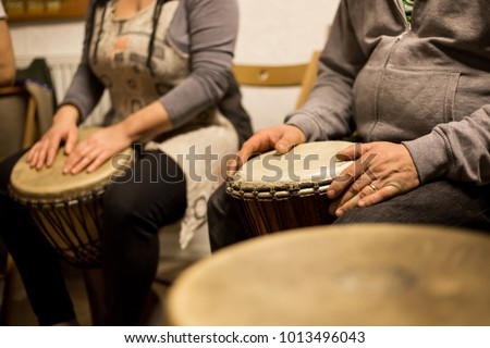 Close up of hands on african drums, drumming for a music therapy #1013496043