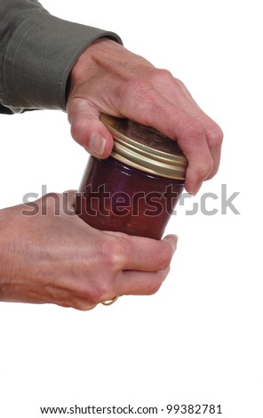 Close up of hands opening a jar.
