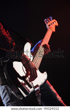 close up of hands playing an bass