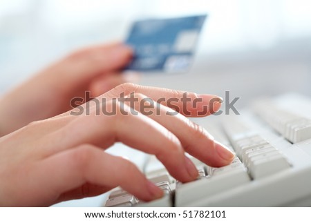 Close-up of hands pressing buttons of keyboard and credit pen #51782101