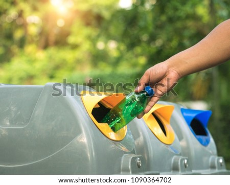 Close up of hands putting water bottles in recycling bin. Recycled waste or garbage can be sold and reused. Global warming concept