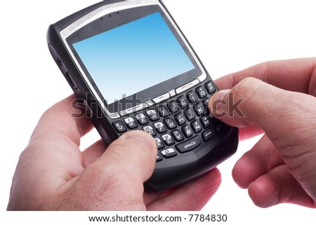 close up of hands typing on a Blackberry