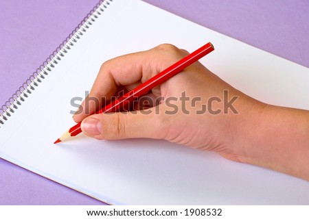 Close-up of hands with a pen on white paper - stock photo