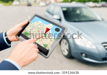 close up of hands with gps on tablet pc and car #359136638