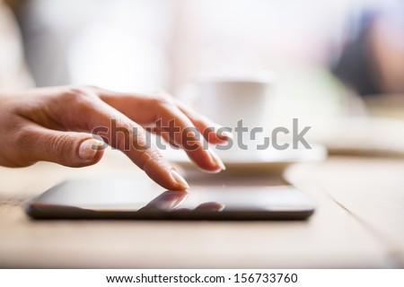 Close up of hands woman using her cell phone in restaurant,cafe #156733760