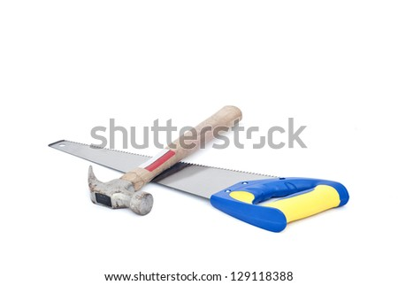 Close up of handsaw and hammer on white background