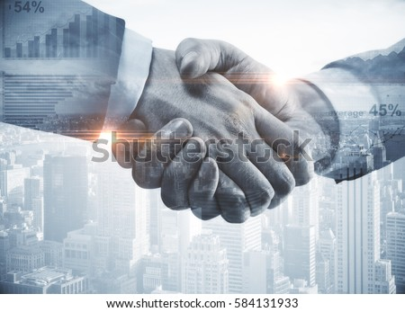 Close up of handshake on abstract city background.Teamwork concept. Double exposure. Filtered image #584131933