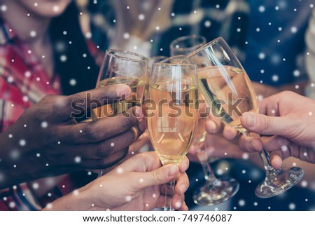 Close up of happy best friends clinking with glasses of wine and toasting on snowflakes background #749746087
