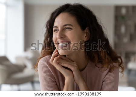 Close up of happy millennial Hispanic woman look in distance dreaming thinking of opportunities perspectives. Smiling young Latino female imagine visualize achievements. Vision, dreamer concept. Stockfoto ©