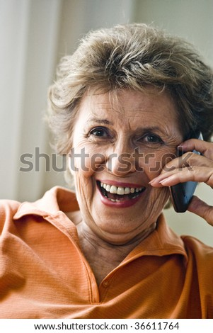Close up of happy senior woman on mobile phone