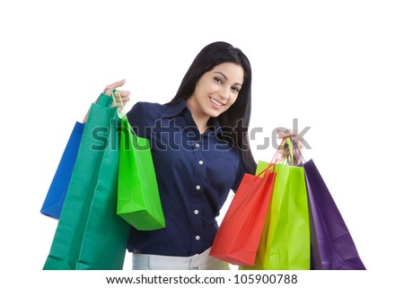 Close-up of happy young woman holding shopping bags isolated on white background.