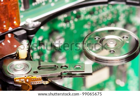 close up of hard disk head - stock photo