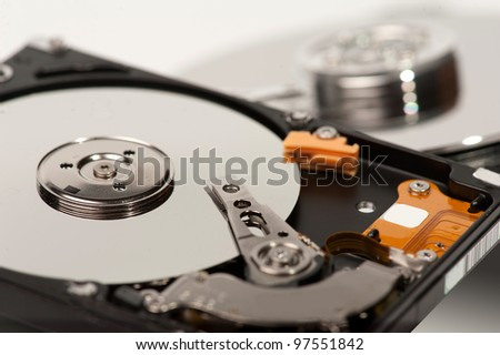 close up of hard disk with blurred another hard disk in background