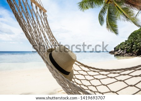 Close-up Of Hat Over The Hammock Near The Coast At Idyllic Beach #1419693707