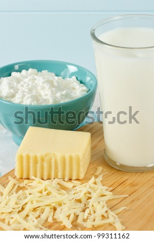 Close up of healthy dairy products includes milk, cottage cheese and shredded Swiss cheese - stock photo
