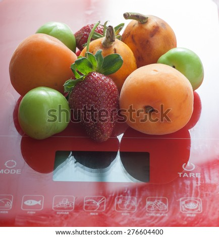 Close up of healthy fruits on kitchen scale
