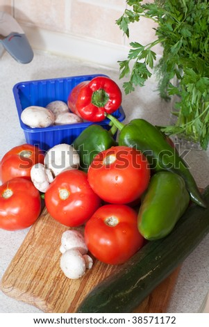 Close up of heap of fresh veggies on wooden board