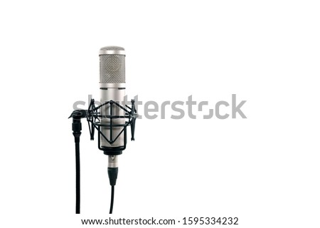 Close up of high fidelity microphone hanging  on holder isolated on white background for youtuber and vlogger. High quality condencer microphone with clipping path.  Stock photo ©