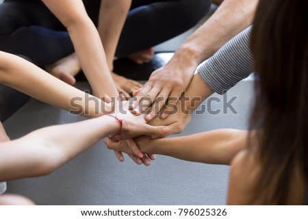 Close up of high five hand gesture, symbol of common celebration or greeting, people planning to reach their goal, slap each other to start working together. Success and teamwork concept