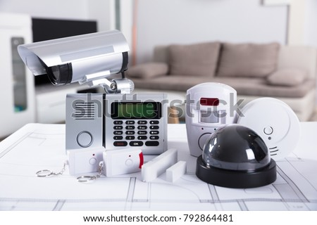 Close-up Of Home Security Equipment On Blueprint
