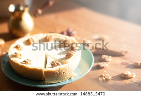 close up of homemade cake, homemade pie with nuts and spices, good illustration for baking and cozy mood with copy space