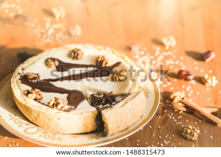 close up of homemade cake, homemade pie with nuts and spices, good illustration for baking and cozy mood