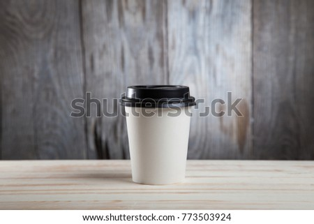 Close up of hot black coffee paper cup on on wooden table. #773503924