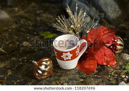 Close up of hot coco cup with christmas decorations