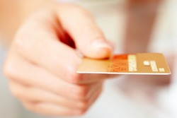 Close-up of human hand holding credit card