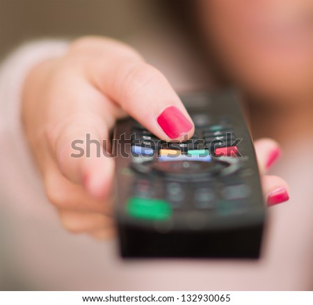 Close-up Of Human Hand Holding Remote