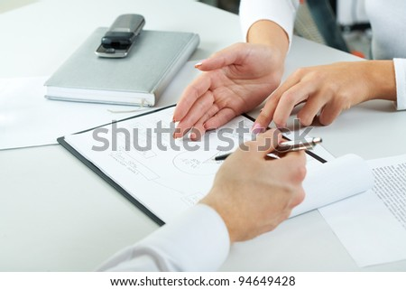 Close-up of human hands during paperwork at business meeting