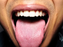 Close up of human teeth, gum, throat, tongue, and lip. Concept of dental healthcare