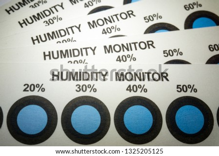 Close-up of humidity indicator cards from electronics manufacturing industry with blue indicator dots