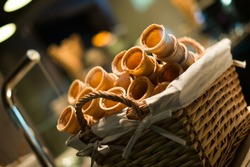 Close up of ice cream cones in whicker basket