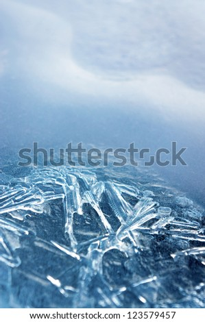 Close up of ice crystals forming beautiful shapes in recently frozen lake - stock photo