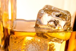close-up of ice cubes in the whiskey on white background