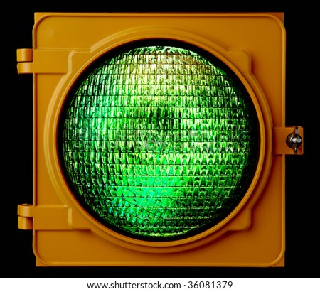 Close up of illuminated green traffic light lens
