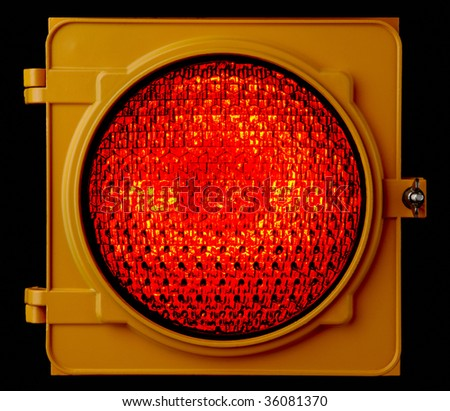 Close up of illuminated red traffic light lens