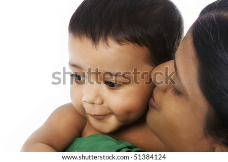 Close-up of Indian mother holding her lovely baby in her hands showing deep affection on white background.