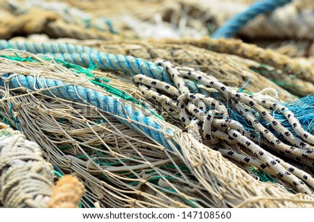 Close up of industrial fishing nets in port