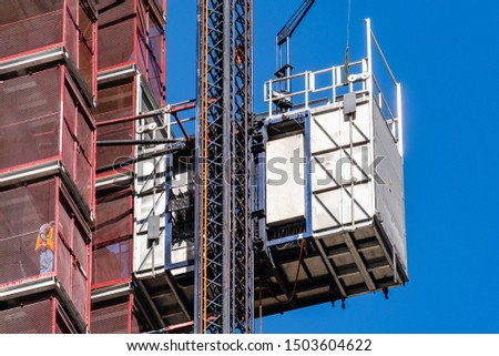 Close up of industrial hoist used to lift workers and materials at a construction site