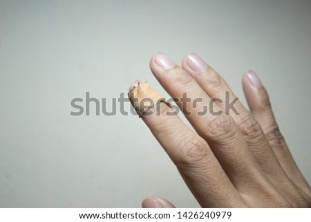 Close up of injured finger with finger plaster adhesive-image #1426240979